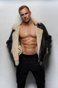 Muscular handsome sexy guy posing wearing jacket