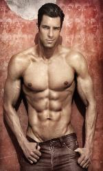 Handsome muscular man posing against vibrant elegant background